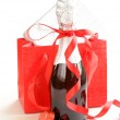 Festive bottle of champagne with chocolate and gifts — Stock Photo