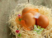 Decorative easter eggs on wooden background — Stock Photo