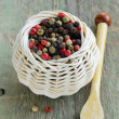 Stock Photo: Colorful peppercorn in wicker bowl