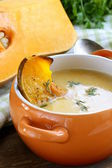Pumpkin cream soup with pieces roasted pumpkin and thyme — ストック写真
