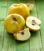 Ripe yellow quince on a wooden table — Stock Photo
