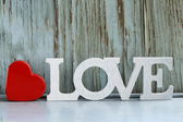 Word love made of white wooden letters on vintage background — Foto Stock