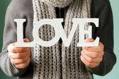 Man holding the wooden word love — Fotografia Stock