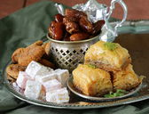Assorted eastern sweets - baklava, dates, turkish delight — Stock Photo