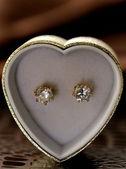 Gold earrings stud with diamonds macro shot — Stock Photo