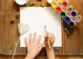 Painting set - brushes, paints (gouache) on old wooden table — Stock Photo