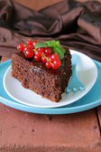 Super chocolate cake (brownie) decorated with red currant and mint — Stock Photo