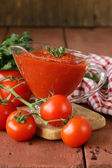 Traditional tomato sauce in a glass gravy boat — Stock Photo