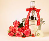 Romantic still life champagne, roses, gifts, chocolate — Stock Photo
