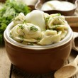 Traditional Russidumplings served with dill and sour cream — Stock Photo #39866255