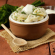 Traditional Russidumplings served with dill and sour cream — Stock Photo #39866285