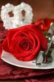 Romantic table setting with roses for the holiday St. Valentine — Stock Photo