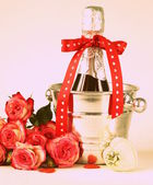 Romantic still life champagne, roses, gifts, chocolate (toned in retro style) — Stock Photo