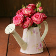 Bouquet of pink flowers roses in old fashioned watering can — Stock Photo #40099441