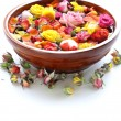 Wooden bowl with roses and petals of flowers - spa concept — Stock Photo #40170103