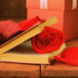 Romantic still life book and red rose on wooden background — Stock Photo