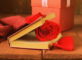 Romantic still life book and red rose on wooden background — Zdjęcie stockowe