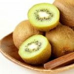 Tropical fruit fresh sweet ripe kiwi on wooden plate — Stock Photo #40553237
