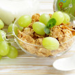 Stock Photo: Healthy breakfast of muesli with milk and green grapes