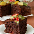 Stock Photo: Chocolate brownie cake decorated with different fruits