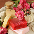 Handmade soap with the scent of roses on a wooden table — Stok fotoğraf