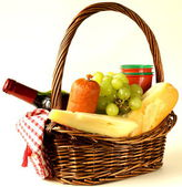 Picnic basket - wine, fruit, cheese and sausage, toned photo — Zdjęcie stockowe