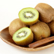 Tropical fruit fresh sweet ripe kiwi on wooden plate — Stock Photo #41121505