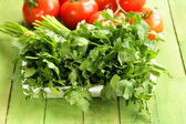 Green fresh organic parsley in a wooden box — Stok fotoğraf