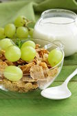 Healthy breakfast of muesli with milk and green grapes — Stock Photo
