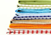 Stack of colorful kitchen napkins on white background — Stock Photo