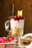 Dairy dessert trifle with cherry in a glass — Stock Photo