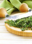 Fresh fragrant green thyme on a cutting board — Stock Photo