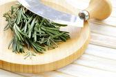 Fresh fragrant green rosemary on a cutting board — Stock Photo