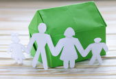 Colorful origami paper house with human family — Stockfoto