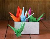 Colorful paper origami birds Japanese symbol — Stock Photo