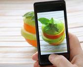Smartphone shot food photo - slices green apple and orange — Stock Photo