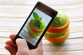Smartphone shot food photo - slices green apple and orange — Стоковое фото