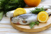 Fresh raw trout fish on the kitchen board — Stock Photo