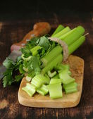 Chopped green celery on a kitchen wooden board — Stock Photo