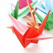 Colorful paper origami birds on a white background — Stock Photo #44623171