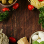 Italian still life - olives, mozzarella cheese, pasta, tomatoes — Stock Photo #44767239