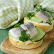 Snack sandwiches with cucumber and herring — Stock Photo #45112589