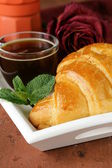 Elegant coffee break or breakfast cup of coffee and croissant — Stock Photo