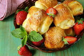 Sweet muffins with strawberries and sugar - homemade pastries — Stock Photo