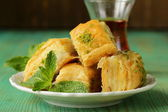Traditional Turkish arabic dessert - baklava with honey and pistachios — Stock Photo