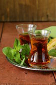 Traditional Arabic Turkish tea served with fresh mint — Stock Photo