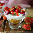 Dairy yogurt dessert with cherries and strawberries — Stock Photo #46554387