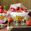 Dairy yogurt dessert with cherries and strawberries — Stock Photo #46554409