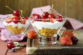 Dairy yogurt dessert with cherries and strawberries — Stock Photo