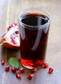 Glass of fresh pomegranate juice from organic fruits — Stock Photo